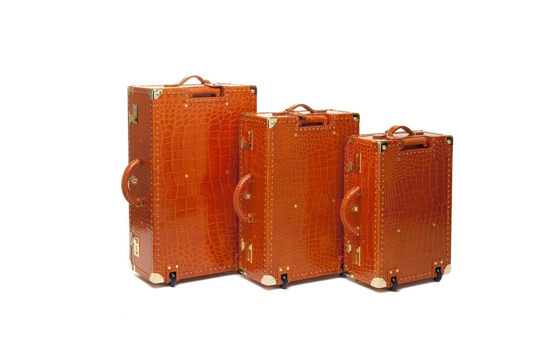 elite luxury accessories orange luggages